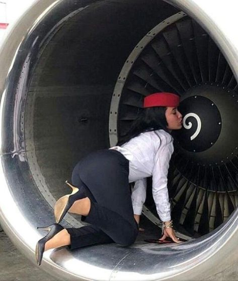 More female airline crew, ground staff and flight attendants wearing uniforms with very tight pencil skirts: Not a pencil sk.