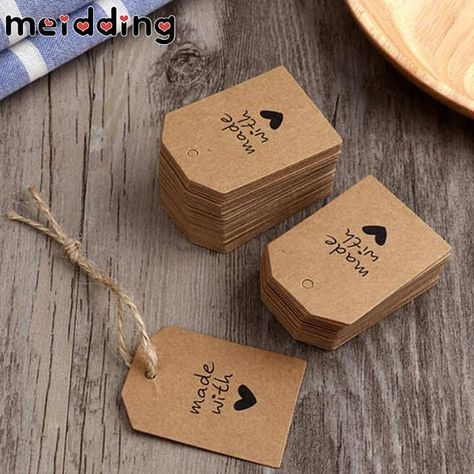 Tags come with holes punched but are not pre-strung. Material: Kraft Paper Size(L x W): Approx. 5.5 x 4.0cm/2.17 x 1.57 inch Rope length: Approx. 10cm/3.9 inch Color: Brown Package Includes: 100 x Paper Label Tags. Note: 1.The colors may have different as the difference
