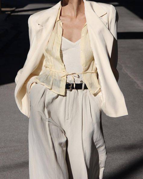 How To Wear White High Waisted Pleated Pants This Summer Our new fashion obsession