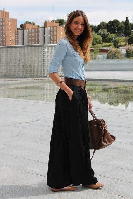 Pale blue chambray blouse and black maxi skirt with wide belt.