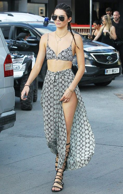 The Best Celebrity Vacation Looks, Period #vacationlooks Kendall Jenner back at it again showcasing her long legs with a maxi skirt, and a matching bralette top. #vacaygoals