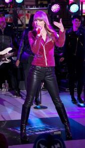 Taylor Swift in Maroon shirt and black leather pants with black high heels