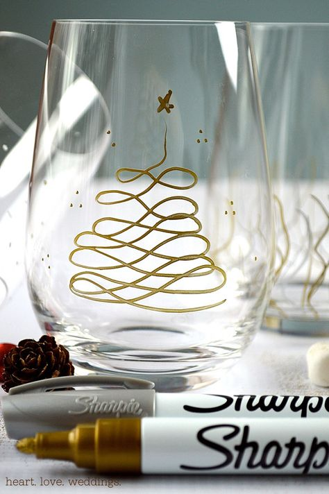 Use silver and gold Sharpie paint pens to make our Christmas glasses this holiday season! Perfect as a hostess gift, to serve champagne or dessert in!
