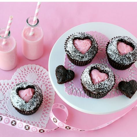 These pretty-in-pink cupcakes are filled with a sweet cherry frosting, then topped with powdered sugar.