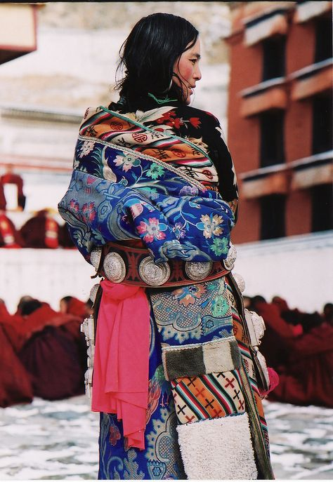 Tibetan woman wearing a traditional dress with a combination of textiles hand crafted with Yak wool and silk decors.  Labrang monastery, Amdo, Tibet | Flickr - Photo