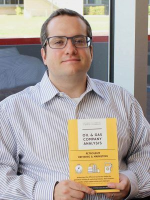 Alfonso Colombano holds his first book, Oil and Gas Company - company analysis