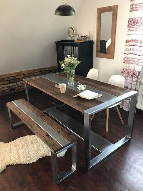 Industrial yet rustic style dining table and bench set. This beautiful kitchen dining set is hand crafted using reclaimed wood and industrial steel. Wood that is over 100 years old is lovingly reconditioned and combined with brushed steel to create this solid piece of original