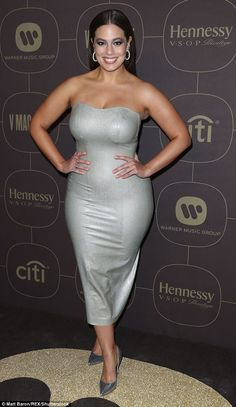 Shiny: Ashley, added silver heels to complete the ensemble. Her hair was worn loose with a center parting and styled sleekly down her back and she added silver hoop earrings