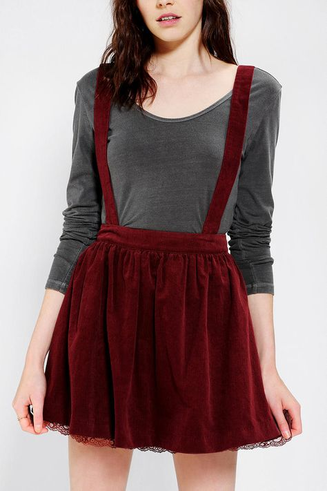 Urban Outfitters Corduroy Suspender Skirt in Navy. Pair with a knit legging and a beige ankle boot with a tight long sleeved shirt and a wrap around scarf for a cute casual day.