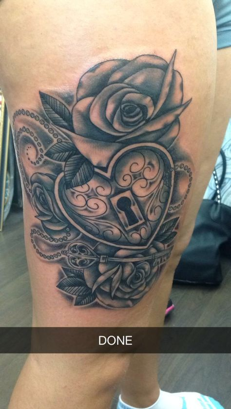 Rose with heart locket tattoo