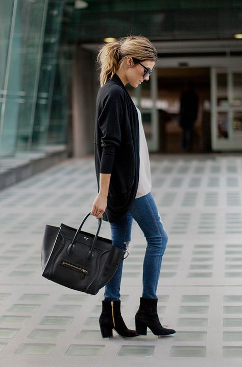 Oversized black cardigan, white tee, skinny jeans, and ankle boots.