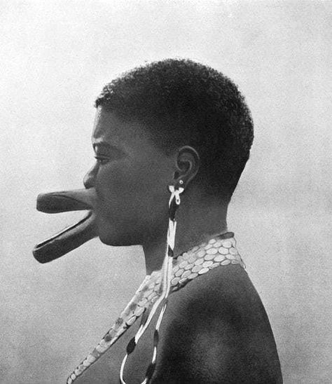 """Via collection of old photos """"Artificial deformation. All the women of Sara[-Djingé] tribe have artificial deformation of the lips as a sign of beauty. The effect is produced by piercing the lips and gradually enlarging the holes by inserting wooden."""