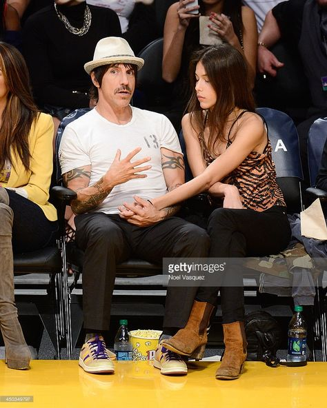 Anthony Kiedis (L) and Helena Vestergaard attend a basketball game between the…