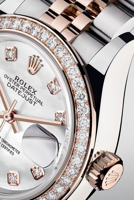 The Rolex Lady-Datejust 28 in Everose Rolesor with a diamond-set bezel and a white mother-of-pearl dial. The Rolex Lady-Datejust 28 in Everose Rolesor with a diamond-set bezel and a white mother-of-pearl dial.