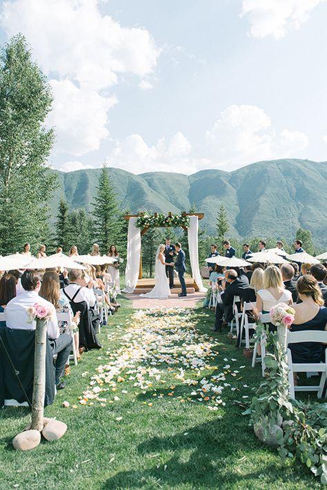 A mountaintop wedding ceremony in Aspen | @kateholstein | Brides.com