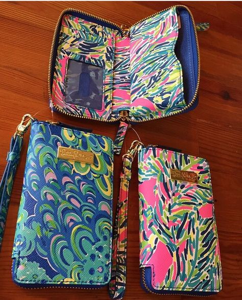 Lilly Pulitzer wristlets! Holds an iPhone 6, cash, ID, and credit cards!