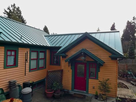 Green roof paint combo.. sorta of mimics the color of a cedar siding on ranch house with pergola, ranch style home remodel before and after, ranch house with driveway, ranch house with clerestory, ranch house with slate, ranch house with mulch, ranch house with courtyard, ranch house with eaves, ranch house with balcony, ranch house with veranda, ranch house with solar, ranch house with swimming pool,