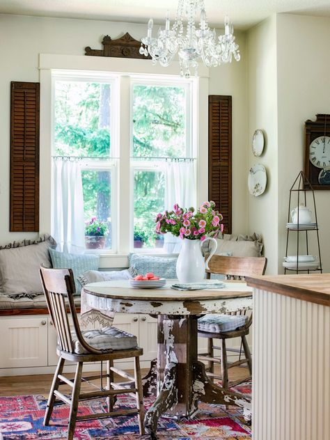 To unite your kitchen with an adjacent dining nook, use similar decor elements in both spaces, but also consider treatments to make each space unique. #breakfastnookidea #eatinkitchen #breakfastnookbench #bhg