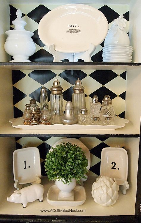 black and white themed china cabinet - white typography and numbered accessories : A Cultivated Nest