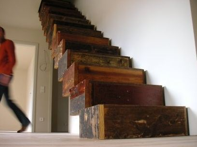 These stairs look gorgeous! They are made from a huge variety of wood, from antique hardwood floor to construction wood and even crates!