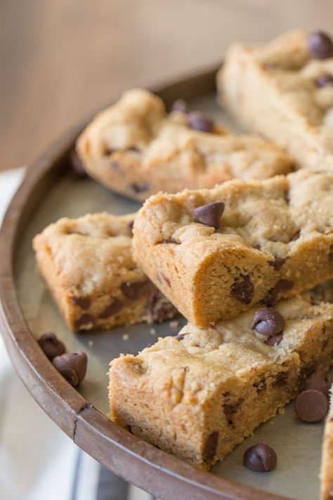 These Peanut Butter Chocolate Chip Cookie Bars are perfect for when you need a soft, chewy cookie in a hurry! #cookiebars #peanutbutter #chocolatechip #cookies #dessert