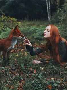 Photographer Alexandra Bochkareva loves working with redheaded models. However, series Autumn and Winter had double the pleasure because there were two red-haired beauties in front of her manual Helios lens - Polina or Olga and a trained fox named Alice.