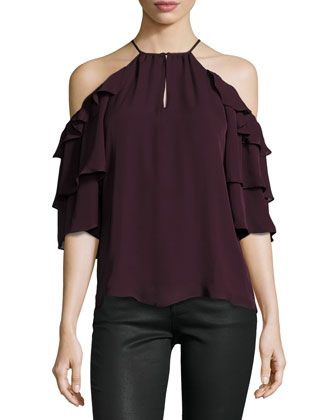 fbbf79a4393f39 Cold shoulders with ruffle trim. Tiered three-quarter sleeves. Slim  silhouette. Slip-over style. Silk  lining