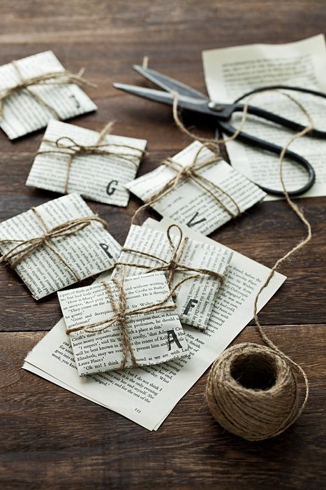 Tiny packages wrapped in vintage book pages and twine.