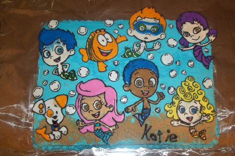Bubble Guppies cake I made for her 2nd birthday. Hand drawn Wilton Color Flow images. Gotta work on the blue running next time.