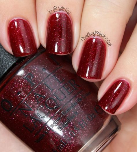 "OPI: Mariah Carey Holiday 2013 Collection Swatches ""Underneath The Mistletoe"" is a silver and red microglitter filled red jelly"
