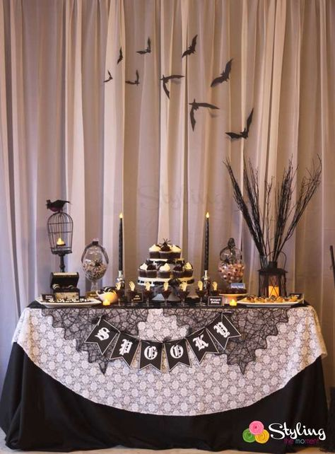 Black and white Halloween party dessert table! See more party planning ideas at CatchMyParty.com!