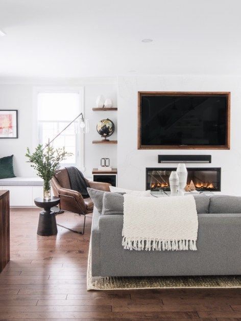 Gray Sofa Leather Accent Chairs Tv Over The Fireplace Open Shelves On Either Side Of The Fire Brown Living Room Decor Living Room Diy Living Room Designs