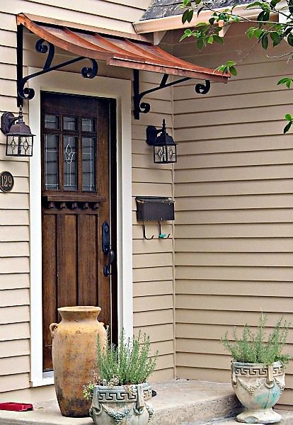 The Copper Concave Door Awning In New Orleans La Door Awnings Awning Over Door Front Door Awning