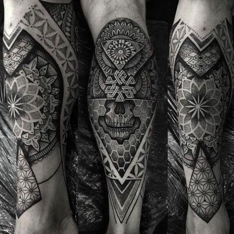 skull leg tattoo, mandala tattoo design, black background