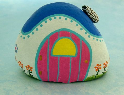 Ready to ship! Quaint colorful painted rock fairy cottage with a bright pink door, hinges and door nob made of gold, a stone chimney for the