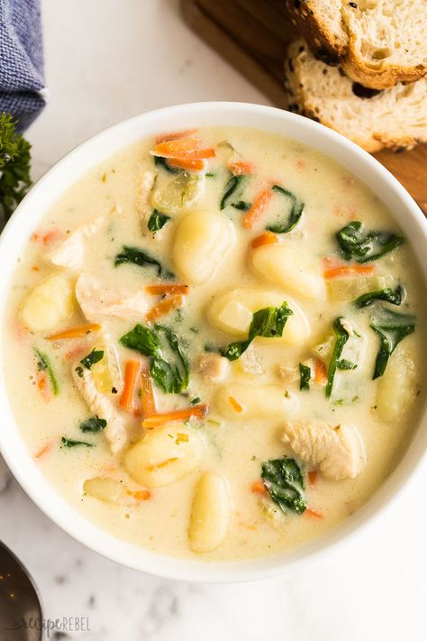 This Chicken Gnocchi Soup is better than Olive Garden! Loaded with tender chicken, chunks of vegetables, spinach in a creamy, flavorful broth - don't forget the crusty bread! #soup #recipe #dinner #chicken