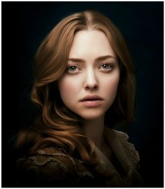 Amanda Seyfried by Annie Leibovitz 2012 I love the painterly look to this and how she's coming out of the black.