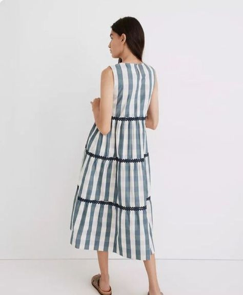She's a best seller for a reason: This gingham tank dress has swingy ruffled tiers and retro-cool rickrack trim. A summer dream with flat sandals and a straw hat (meadow for strolling: optional). From Madewell