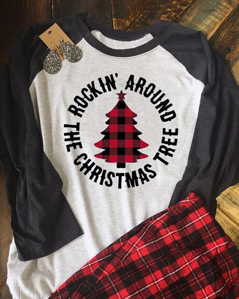 Rockin' Around Christmas Tree T-Shirt. We do not use heat transfer vinyl, iron-on transfers or screen printing. We use a cutting edge professional DTG printing process that puts eco-friendly ink directly into the fabric. Home T Shirts, Vinyl Shirts, Arrow T Shirt, Harajuku, Christmas Sweaters, Christmas Outfits, Christmas Tee Shirts, Christmas Clothing, Christmas T Shirt Design