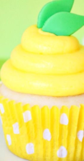 Lemon Pudding Cupcakes ~ A sweet little white cupcake filled with yummy lemon pudding, topped with lemon buttercream