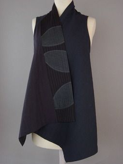 Juanita Girardin:Wrapped Shoulder Vest in Black and Indigo with Leaf Fragments This dark indigo cotton from Japan is almost navy blue. Gray leaf fragments are sandwiched between cotton and silk.