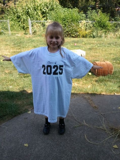 Put the child's graduation year on a large t-shirt. Take a picture each year with same shirt to watch the kid grow into the shirt.----->cute!