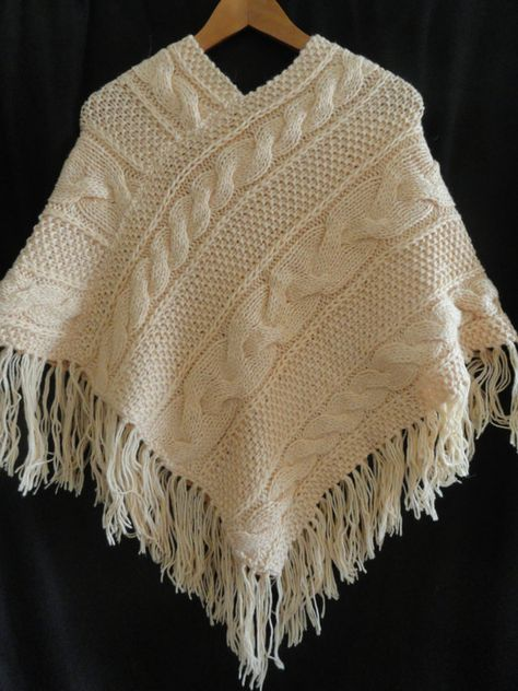 This hand knit wool poncho is the perfect gift for that special someone or maybe just a treat for you! It is from wool and acrylic yarn, peach color. The poncho is suitable for women and girls. It is very comfortable to wear, warm and cozy, it is sure to turn heads. SIZE: I would call