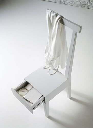 White wooden chair with a secret drawer. Perfect for small spaces