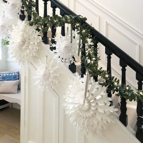 This Christmas I have created more of a sweeping look on the bannisters using faux eucalyptus, little LED fairy lights and the paper snowflakes that I re-used from the branch.