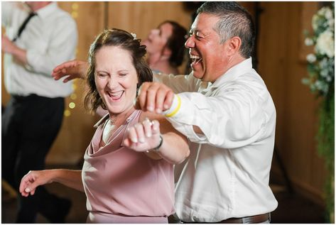 Parents busting a move during party dancing in barn | Oak Hills Utah Dusty Rose and Gray Summer Wedding | Jessie and Dallin Photography #utahwedding #utahsummerwedding #summerwedding #mountainwedding #rockymountainwedding #blushandgraywedding #blushandgray #oakhillsutah #utahweddingvenue