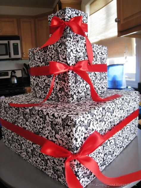 Cute idea for a cupcake stand! Just wrap boxes in your color of wrapping paper and add ribbon! So simple.