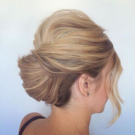 low french twist updo with a bouffant and bangs