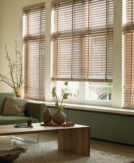 wooden blinds with a white windowsill