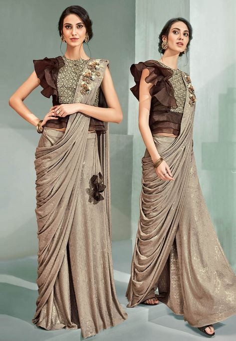 Embossed lycra beige party wear saree with blouse raw silk and otganza brown color. Designer sarees work Cord and Sequins embroidery, handwork butta. Wedding saree available with a semi-stitched lycra net blouse in brown. Blouse length- 17 to 18 inches an